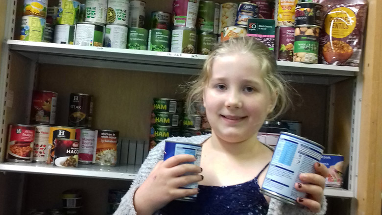 A 9-year-old's joy at foodbank volunteering